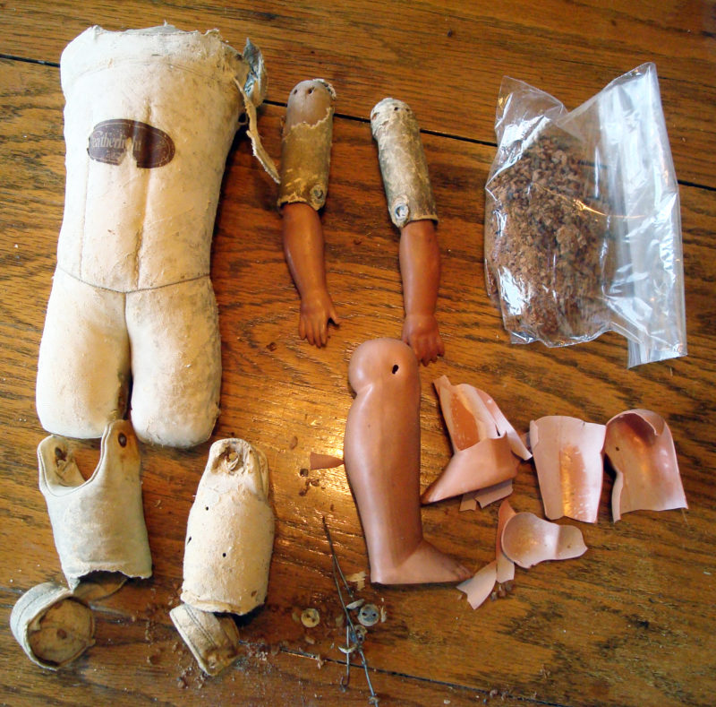 celluloid doll repair on an old leather doll body
