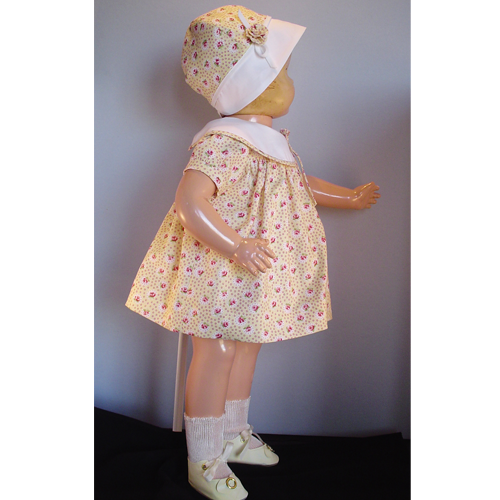 Side view of a yellow Effanbee Patsy dress.